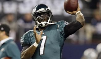 FILE - In this Dec. 29, 2013, file photo, Philadelphia Eagles quarterback Michael Vick tosses a football before an NFL football game against the Dallas Cowboys in Arlington, Texas. Vick is the new No. 1 for the New York Jets. The veteran quarterback initially chose earlier this week to wear No. 8 with his new team, but announced on Twitter on Friday, May 2, 2014, that he was going with jersey No. 1. (AP Photo/Tony Gutierrez, File)