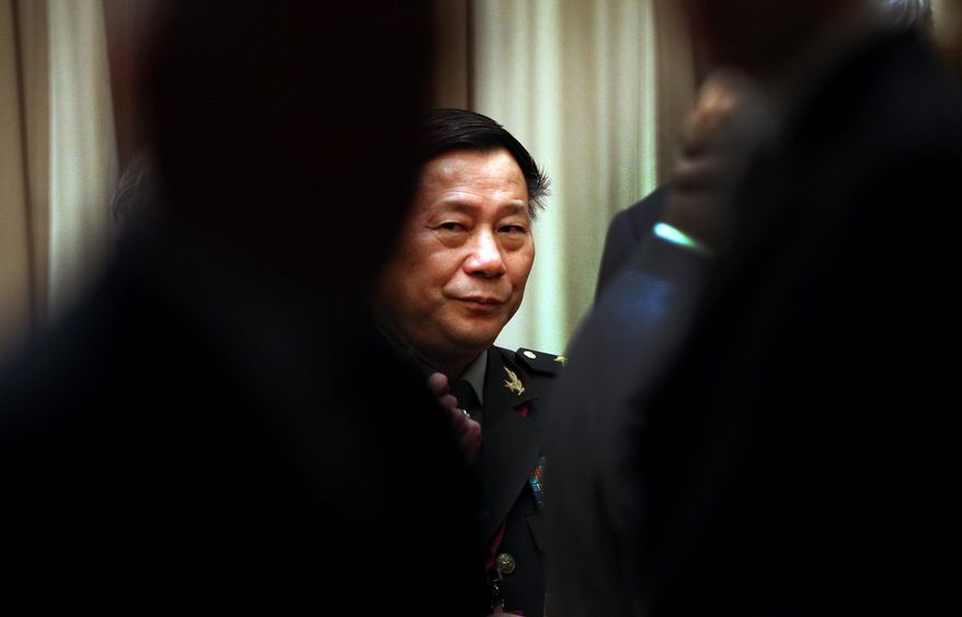 Lt. Gen. Qi Jianguo, deputy chief of general staff of People's Liberation Army of China, accused Washington of being the mastermind behind a conspiracy to deprive Africa of peace and prosperity and lauded anti-West dictators at an April 27 banquet in Harare, Zimbabwe. (Associated Press)