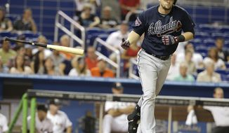 Atlanta Braves' Chris Johnson draws a walk in the eighth inning in the of a baseball game against the Miami Marlins, Thursday, May 1, 2014, in Miami. The Marlins defeated the Braves 5-4. (AP Photo/Lynne Sladky)