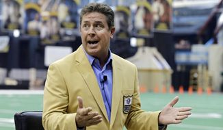 Miami Dolphins Hall of Fame quarterback Dan Marino speaks to reporters about the Pro Football Hall of Fame fanjets at the I-X Center in Cleveland Tuesday, April 29, 2014. The inaugural fanfest features 100 members of the Pro Football Hall of Fame interacting with fans May 3-4, 2014. (AP Photo)