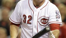 Cincinnati Reds' Jay Bruce tosses his bat after striking out against Milwaukee Brewers starting pitcher Wily Peralta in the sixth inning of a baseball game on Friday, May 2, 2014, in Cincinnati. (AP Photo/Al Behrman)