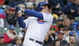 Chicago Cubs' Anthony Rizzo hits a home run off St. Louis Cardinals starting pitcher Adam Wainwright during the fifth inning of a baseball game on Friday, May 2, 2014, in Chicago. (AP Photo/Charles Rex Arbogast)
