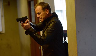 """This image released by Fox shows Kiefer Sutherland in a scene from """"24: Live Another Day,"""" premiering Monday, May 5 at 8 p.m. EDT on Fox. (AP Photo/Fox, Daniel Smith)"""