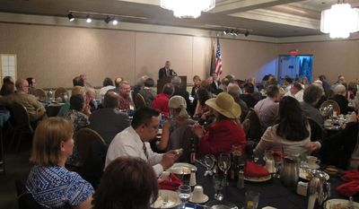 State Republican Party Chairman Peter Goldberg addresses attendees of a dinner during the state party convention headlined by Republican National Committee co-chair Sharon Day on Thursday, May 1, 2014, in Juneau, Alaska. (AP Photo/Becky Bohrer)