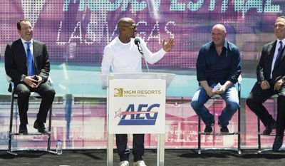 Undefeated boxing champion Floyd Mayweather Jr., gets the crowd laughing during his speech at the AEG and MGM Resorts International ground breaking VIP/media event on Thursday, May 1, 2014.  (AP Photo/Las Vegas Sun, L.E. Baskow)