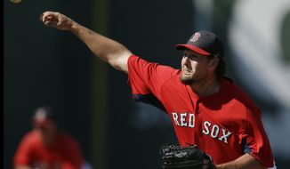 FILE-- In this March 30, 2013, file photo, Boston Red Sox relief pitcher Joel Hanrahan deliverin during an exhibition spring training baseball game against the Minnesota Twins in Fort Myers, Fla. Hanrahan has agreed to a one-year deal with the Detroit Tigers on Friday, May 2, 2014. The Tigers are hopeful the right-hander can bolster a shaky bullpen when he finally returns from elbow surgery. (AP Photo/Elise Amendola, File)