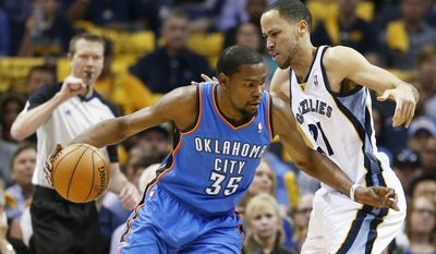 Oklahoma City Thunder forward Kevin Durant (35) drives against Memphis Grizzlies forward Tayshaun Prince (21) in the first half of Game 6 of an opening-round NBA basketball playoff series Thursday, May 1, 2014, in Memphis, Tenn. (AP Photo/Mark Humphrey)