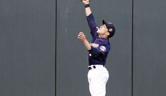 Minnesota Twins center fielder Sam Fuld (1) makes a leaping catch on a fly to center by Baltimore Orioles' Manny Machado during the first inning of a baseball game in Minneapolis, Friday, May 2, 2014. (AP Photo/Ann Heisenfelt)