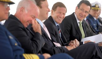 Connecticut Governor Dannel P. Malloy, far right, does some good humored ribbing of Congressman Joe Courtney, left, while Connecticut Senators Chris Murphy and Richard Blumenthal laugh along after Congressman Courtney's late arrival to the ground breaking ceremony for the National Coast Guard Museum at the City Pier Stage on Waterfront Park in New London, Conn., Friday May 2, 2014.  (AP Photo/The Day, Tim Cook)
