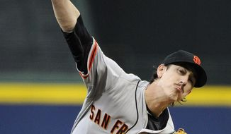 San Francisco Giants starting pitcher Tim Lincecum delivers to the Atlanta Braves during the first inning of a baseball game Friday, May 2, 2014, in Atlanta. (AP Photo/David Tulis)