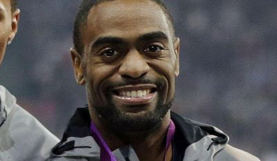 FILE - In this Aug. 11, 2012, file photo, Tyson Gay celebrates after receiving the silver medal for the men's 4x100-meter race during the athletics competition in the Olympic Stadium at the 2012 Summer Olympics, London. Gay has accepted a one-year suspension and has returned the silver medal he won at the London Olympics after he tested positive for a prohibited substance, USADA announced Friday, May 2, 2014. (AP Photo/Matt Slocum, File)