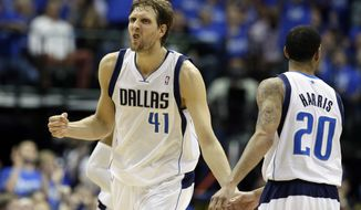 Dallas Mavericks' Dirk Nowitzki (41), of Germany, celebrates after sinking a long two-point basket with Devin Harris (20) against the San Antonio Spurs in the second half of Game 6 of an NBA basketball first-round playoff series on Friday, May 2, 2014, in Dallas. The Mavericks won 113-111. (AP Photo/Tony Gutierrez)