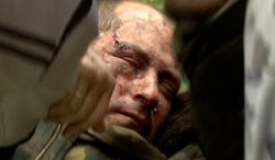 ** FILE ** In this image taken from Rossia 24 television channel TV, an injured Ukrainian military helicopter pilot is assisted by pro-Russian activists after he was shot down in Slovyansk, eastern Ukraine, Friday May 2, 2014. (AP Photo/Rossia 24 Television Channel)