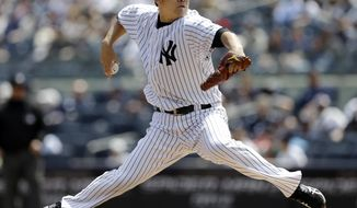 New York Yankees' Masahiro Tanaka, of Japan, delivers a pitch during the first inning of a baseball game against the Tampa Bay Rays Saturday, May 3, 2014, in New York. (AP Photo/Frank Franklin II)