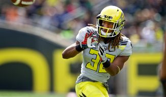 Oregon's Ayele Forde catches a pass during their spring NCAA college football game on Saturday, May 3, 2014, at Autzen Stadium in Eugene, Ore. (AP Photo/The Oregonian, Thomas Boyd)  MAGS OUT; TV OUT; LOCAL TV OUT; LOCAL INTERNET OUT; THE MERCURY OUT; WILLAMETTE WEEK OUT; PAMPLIN MEDIA GROUP OUT