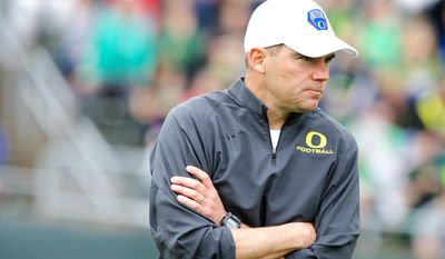 Oregon coach Mark Helfrich coaches during the Ducks spring NCAA college football game on Saturday, May 3, 2014, at Autzen Stadium in Eugene, Ore. (AP Photo/The Oregonian, Thomas Boyd)  MAGS OUT; TV OUT; LOCAL TV OUT; LOCAL INTERNET OUT; THE MERCURY OUT; WILLAMETTE WEEK OUT; PAMPLIN MEDIA GROUP OUT