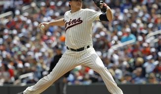 Minnesota Twins starting pitcher Kevin Correia delivers to the Baltimore Orioles during the third inning of a baseball game in Minneapolis, Saturday, May 3, 2014. (AP Photo/Ann Heisenfelt)
