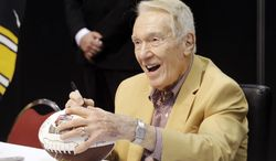 Hall of Fame coach Marv Levy signs autograph for fans at the inaugural Pro Football Hall of Fame Fan Fest Saturday, May 3, 2014, at the International Exposition Center in Cleveland. With openly gay player Michael Sam about the be drafted into the NFL, Levy and several other Hall of Famers believe he will be readily accepted into the league and won't endure any discrimination. (AP Photo/Mark Duncan)