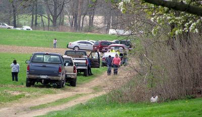 This was the scene Saturday, May 3, 2014, as state police notified the families of  two adults and three children who were found dead in a cabin in rural Washington Township by a friend sometime in the late morning.  State Police Capt. David Young said the preliminary investigation showed no signs of foul play and the cause of the deaths was not considered suspicious. But state police are looking at all possibilities, including carbon monoxide poisoning, he said. A propane heater was found inside the cabin.  (AP Photo/Sun-Gazette, Nico Salvatori)