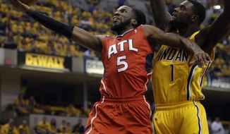 Atlanta Hawks forward DeMarre Carroll (5) shoots in front of Indiana Pacers guard Lance Stephenson (1) in the first half during Game 7 of a first-round NBA basketball playoff series in Indianapolis, Saturday, May 3, 2014. (AP Photo/AJ Mast)