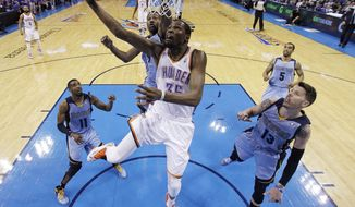 Oklahoma City Thunder forward Kevin Durant (35) shoots in front of Memphis Grizzlies guard Mike Conley (11), guard Tony Allen (9) and forward Mike Miller (13) in the second quarter of Game 7 of an opening-round NBA basketball playoff series in Oklahoma City, Saturday, May 3, 2014. (AP Photo/Sue Ogrocki)