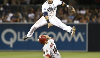 San Diego Padres shortstop Everth Cabrera sails over Arizona Diamondbacks' Paul Goldschmidt while relaying to first to complete a double during the eighth inning of a baseball game Friday, May 2, 2014, in San Diego.  (AP Photo/Lenny Ignelzi)