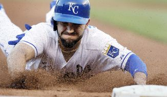 Kansas City Royals' Eric Hosmer slides into third base during the fourth inning of a baseball game against the Detroit Tigers in Kansas City, Mo., Saturday, May 3, 2014. Hosmer advanced on a wild pitch by Tigers starting pitcher Drew Smyly. (AP Photo/Orlin Wagner)