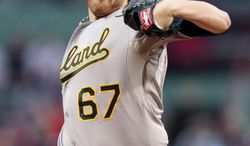 Oakland Athletics starting pitcher Dan Straily delivers to the Boston Red Sox during the first inning of a baseball game at Fenway Park in Boston, Friday, May 2, 2014. (AP Photo/Charles Krupa)