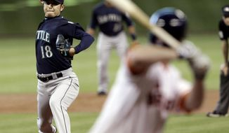 Seattle Mariners' Hisashi Iwakuma (18) delivers a pitch to Houston Astros' Matt Dominguez in the first inning of a baseball game on Saturday, May 3, 2014, in Houston. (AP Photo/Pat Sullivan)
