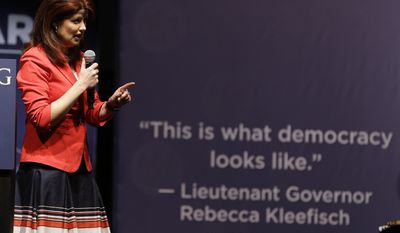 Wisconsin Lieutenant Gov. Rebecca Kleefisch speaks to delegates at the Republican party of Wisconsin State Convention Saturday, May 3, 2014, in Milwaukee. (AP Photo/Jeffrey Phelps)