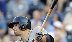 Detroit Tigers' Nick Castellanos hits a sacrifice fly during off Kansas City Royals relief pitcher Danny Duffy during the fourth inning of a baseball game in Kansas City, Mo., Saturday, May 3, 2014. Tigers' Miguel Cabrera scored on the play. (AP Photo/Orlin Wagner)