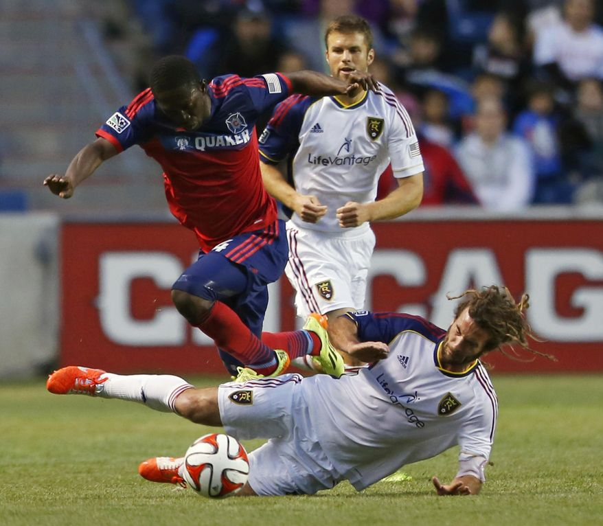 Real Salt Lake midfielder Kyle Beckerman, bottom, tries to stop Chicago Fire forward Patrick Nyarko, top, during the first half of an MLS soccer game on Saturday, May 3, 2014, at Toyota Park in Bridgeview, Ill. (AP Photo/Kamil Krzaczynski)
