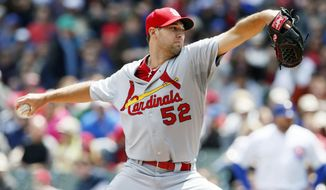 St. Louis Cardinals starting pitcher Michael Wacha delivers against the Chicago Cubs during the first inning of a baseball game on Saturday, May 3, 2014, in Chicago. (AP Photo/Andrew A. Nelles)