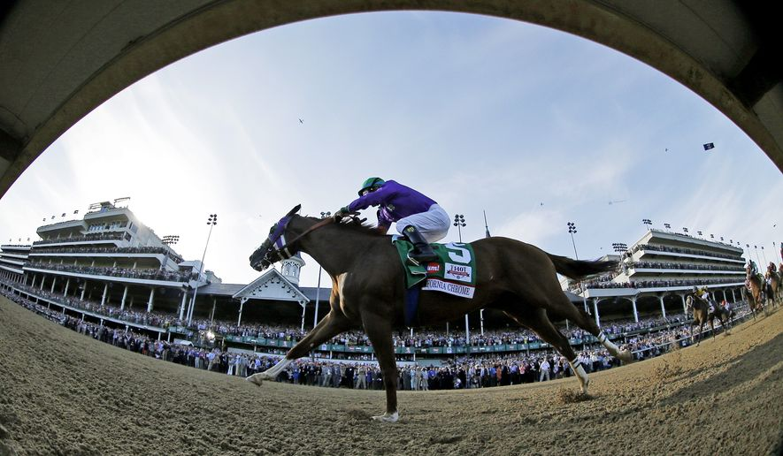 In this image taken with a fisheye lens, jockey Victor Espinoza rides California Chrome to win in the 140th running of the Kentucky Derby horse race at Churchill Downs Saturday, May 3, 2014, in Louisville, Ky. (AP Photo/Matt Slocum)