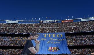 """A banner is displayed reading in Catalan: """"Tito forever eternal"""" in honor for late former FC Barcelona's coach Tito Vilanova prior to the Spanish La Liga soccer match between FC Barcelona and Getafe at the Camp Nou stadium in Barcelona, Spain, Saturday, May 3, 2014. FC Barcelona announced on their web page Friday April 25, 2014, that Vilanova had died following a long battle with throat cancer. He was 45. (AP Photo/Manu Fernandez)"""