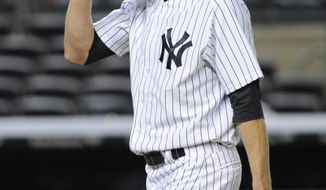 New York Yankees pitcher Chris Leroux reacts as he leaves the mound at the end of the 14th inning of a baseball game against the Tampa Bay Rays Friday, May 2, 2014, at Yankee Stadium in New York. (AP Photo/Bill Kostroun)
