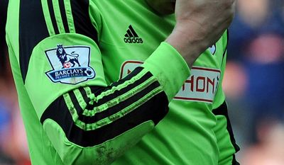 Fulham goalkeeper David Stockdale gestures after being relegated after losing 4-1 to Stoke City during the English Premier League soccer match between Stoke City and Fulham at the Britannia Stadium in Stoke On Trent, England, Saturday, May 3, 2014. (AP Photo/Rui Vieira)