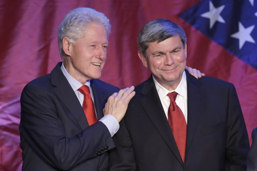 Former President Bill Clinton, left, talks with Former Democratic Congressman Mike Ross at a Ross fund raiser in Little Rock, Ark., Saturday, May 3, 2014. Ross is seeking the Democratic Party nomination in the race for Arkansas Governor. (AP Photo/Danny Johnston)