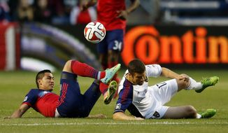 Chicago Fire midfielder Benji Joya, left, battles for the ball with Real Salt Lake defender Chris Wingert, right, during the first half of an MLS soccer game on Saturday, May 3, 2014, at Toyota Park in Bridgeview, Ill. (AP Photo/Kamil Krzaczynski)