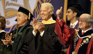 "Vice President Joe Biden, center, smiles after arriving for a graduation ceremony at the Miami Dade College in Miami, Saturday, May 3,2014.   Biden said a ""constant, substantial stream of immigrants"" is important to the American economy, urging citizenship for immigrants living in the U.S. illegally.  (AP Photo/Javier Galeano)"