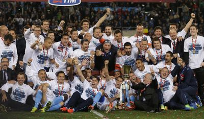 Napoli president Aurelio De Laurentiis lifts the trophy as he celebrates with his team after winning the Italian Cup final match between Fiorentina and Napoli in Rome's Olympic stadium Saturday, May 3, 2014. (AP Photo/Alessandra Tarantino)