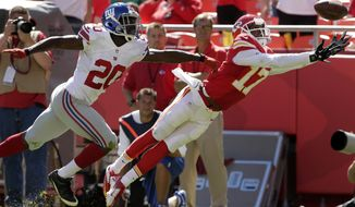 ADVANCE FOR WEEKEND EDITIONS, MAY 3-4 -FILE - In this Sept. 29, 2013, file photo, Kansas City Chiefs wide receiver Donnie Avery (17) dives for the ball while covered by New York Giants cornerback Prince Amukamara (20) during the second half of an NFL football game at Arrowhead Stadium in Kansas City, Mo. The pass was incomplete. Even as NFL teams make a huge deal out of their discoveries from the hinterlands of college football, it's the big schools from the powerhouse conferences that dominate the draft. (AP Photo/Charlie Riedel, File)