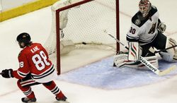 Minnesota Wild goalie Ilya Bryzgalov, right, reacts after Chicago Blackhawks' Patrick Kane scored a goal during the third period  in Game 1 of an NHL hockey second-round playoff series in Chicago, Friday, May 2, 2014. The Blackhawks won 5-2. (AP Photo/Nam Y. Huh)