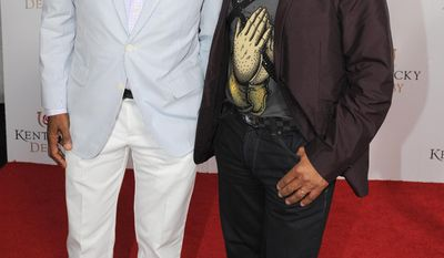 Marlon and Jackie Jackson are photographed at the 140th Kentucky Derby Saturday, May 3, 2014 in Louisville Ky. (Photo by Joe Imel/Invision/AP)