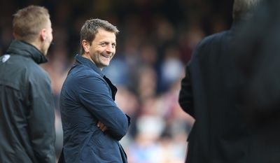 Tottenham's manager Tim Sherwood smiles as he watches his team play from the technical area during their English Premier League soccer match between West Ham United and Tottenham Hotspur at the Boleyn stadium in London Saturday, May  3  2014. (AP Photo/Alastair Grant)