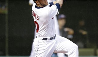 Cleveland Indians' Yan Gomes hits a two-RBI double off Chicago White Sox starting pitcher John Danks in the first inning of a baseball game on Friday, May 2, 2014, in Cleveland. Indians' Michael Brantley and Ryan Raburn scored on the hit. (AP Photo/Tony Dejak)