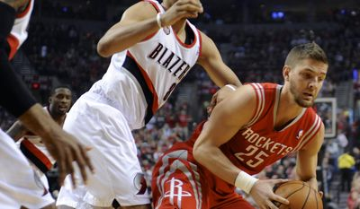 Houston Rockets' Chandler Parsons (25) works against Portland Trail Blazers' Nicolas Batum (88) during the first half of game six of an NBA basketball first-round playoff series game in Portland, Ore., Friday May 2, 2014. (AP Photo/Greg Wahl-Stephens)
