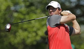Rory McIlroy, of Northern Ireland, watches his tee shot on the 16th hole during the third round of the Wells Fargo Championship golf tournament in Charlotte, N.C., Saturday, May 3, 2014. (AP Photo/Chuck Burton)