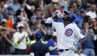 Chicago Cubs' Junior Lake celebrates after hitting a two-run home run during the sixth inning of a baseball game against the St. Louis Cardinals on Saturday, May 3, 2014, in Chicago. (AP Photo/Andrew A. Nelles)