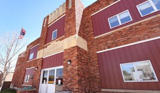 This May 1, 2014 photo shows Elba Public School in Elba, Neb. Elba Public School has an average daily enrollment of 25 or fewer students in ninth through 12th grades. Next year, it is on track to stay that way. Because of a state law, however, that means the school might be forced to close its doors. Superintendent Mikal Shalikow and the school board are searching for options, from bringing in students to unifying or even consolidating with another school. But while Elba's issue is a question of how to keep its school open, as in many small towns, it is also a question of whether the community will survive. (AP Photo/The Independent, Barrett Stinson)